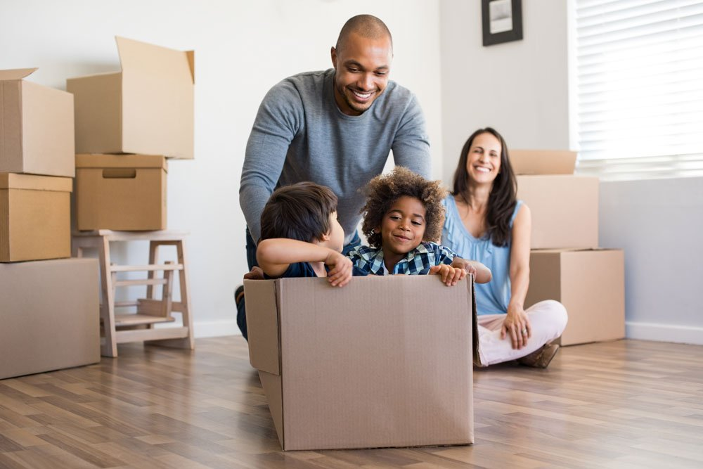 Biracial family of three moving into their new home